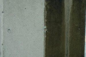 特殊コーティングをして経過3年したコンクリート外壁の写真